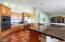 Large kitchen with ISLAND breakfast bar and granite countertops