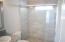 Frameless Glass Shower Enclosure shows off the tile work in the second master bath. As always in this home, natural light abounds.