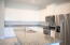 Granite Countertops, Tall Cabinets and Stainless Steel Appliances