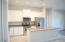 Fabulous, Bright White, Island Kitchen with Stainless Steel Appliances, full extension drawers and extra tall uppers. This is a great kitchen!