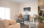 Photo is of a previously constructed home with same floor plan showing staged great room