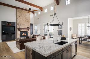 Exposed wood beams, 21' high ceilings and clerestory windows fill the living spaces and the culinary level kitchen with natural light. A free flowing floor plan connects the kitchen to the breakfast room. We love the adjoining breakfast room with those big mountain views.