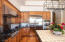 Chef's Kitchen with double ovens, gas cooktop and large island.