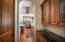 Butlers Pantry and oversized walk in pantry - adjacent to formal dining and kitchen