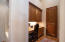 Workspace and storage area from garage entry - built in cabinetry on both sides of garage entry