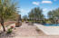 Amazing backyard with expansive grass area, built in bbq, firepit area, pool with diving board, hot tub and trampoline