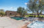The pool features a deep end depth for diving and hot tub is recessed for easy entry/exit.