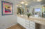 Owner's Bath has large vanity and sink separate from shower and commode.