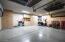 Built-in cabinets. Overhead storage. Epoxy floors.