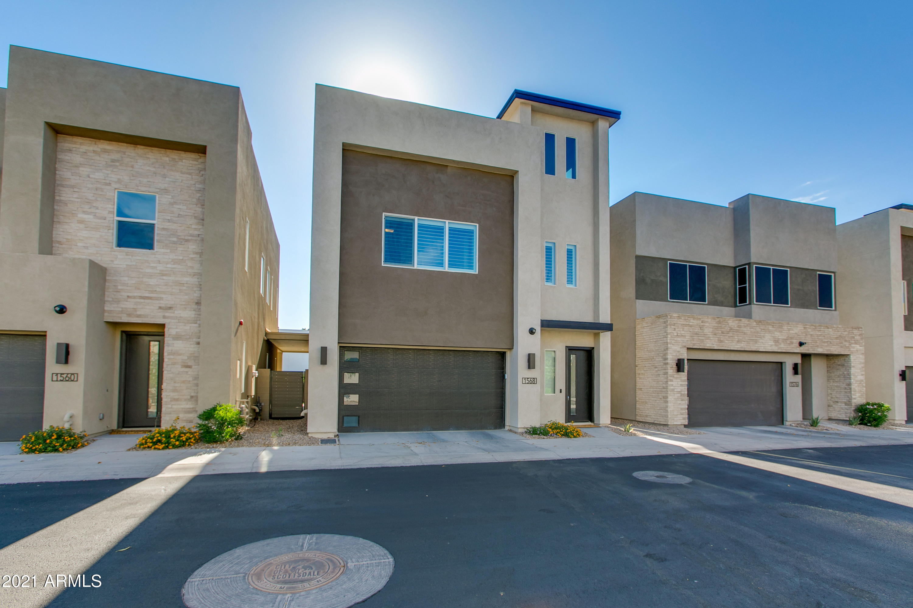 This newer 2019 build is tucked away in the gated community of Skye on Mcdowell. Located just minutes from all of the popular dining and nightlife in Old Town Scottsdale, this fantastic location offers quick access to Papago Park, Indian Bend Wash Greenbelt, Scottsdale Stadium, Fashion Square, Loop 101 & 202 Freeways!  This home will appeal to anyone seeking contemporary design with an open concept and the perfect indoor/outdoor flow. Enjoy a gourmet kitchen with a gas range, large quartz topped island, sleek cabinetry, and stainless appliances. Relax in your low maintenance backyard, under the covered patio, or head upstairs to the rooftop deck to bask in the sunset and savor the stunning 360 degree views!