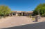 Wide paver driveway and mature, easy care landscaping