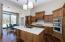 Custom hardwood cabinetry, quartz countertops and walnut flooring