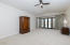Vaulted ceiling, coffee bar w/sink & fridge and direct access to pool/spa