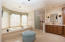 Light & bright w/dual vanities, His/Hers closets, jetted tub & walk-in shower