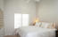 I love the ceiling height in the guest bedrooms.