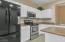 Kitchen with SS and black appliances