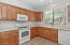 Kitchen has Maple Toffee Cabinets