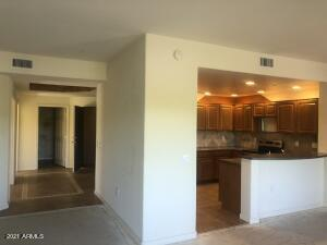 kitchen open to dining and living room and spacious tiled entry way