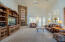 Great room with floor to ceiling stacked stone fireplace, french door to patio