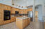 Kitchen with island, french door ss refrigerator, double wall ovens, built-in microwave