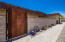 Adobe block wall with gate