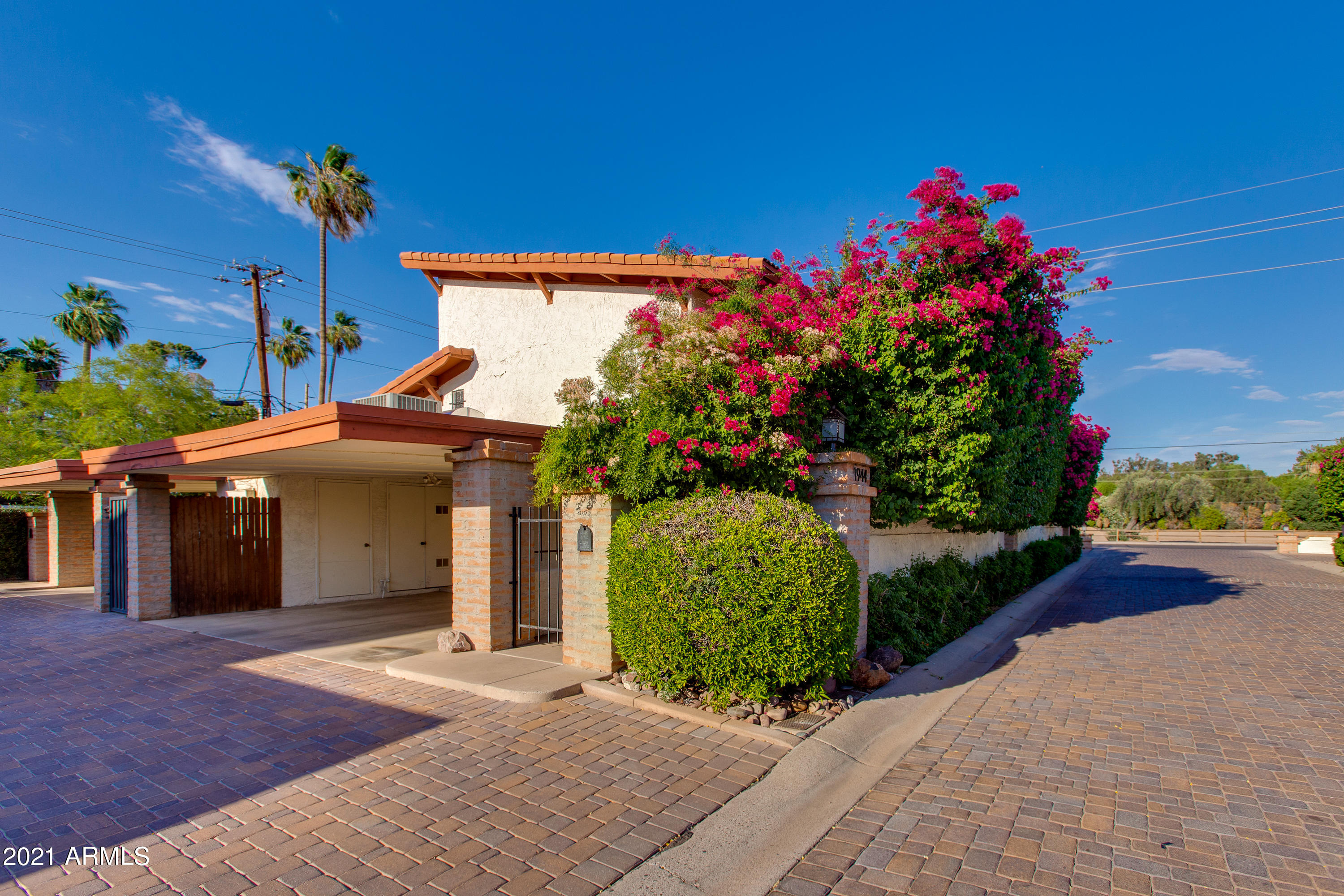 Welcome home to this nicely maintained two-story townhouse in Casa Amertas, a quaint community with a private drive located in a fantastic area near Camelback Colonnade, Town & Country Shopping Center, Biltmore Fashion Park, and AZ-51 Freeway. This clean slate is ready for your personal touches and features living room, dining area, kitchen, and half bath on the first floor, while the two bedrooms and full bathrooms are on the second floor. The master bedroom features a viewing balcony that sits just above the spacious and intimate back patio. With a two-car carport, private laundry room, and community pool, you can enjoy all of the comforts of a single family house in this condo!