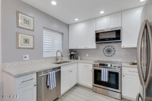 """Remodeled kitchen, quartz counters & 42"""" cabinets"""
