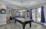 Spacious Game Room looing through Double French Doors into enclosed private Courtyard 2