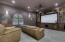 Theater Room with Built-in 7.1 Surround Sound System with special sound dampening insulation in the walls for a real cinematic experience at home
