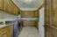 Large walk-in Laundry Room with wrap around custom built-in cabinetry and space for a refrigerator