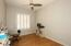 Bedroom 3 has ceiling fan, wood flooring & plantation shutters.