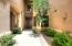 Private gated courtyard entrance.