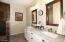 Double sinks, granite countertops & walk in shower.