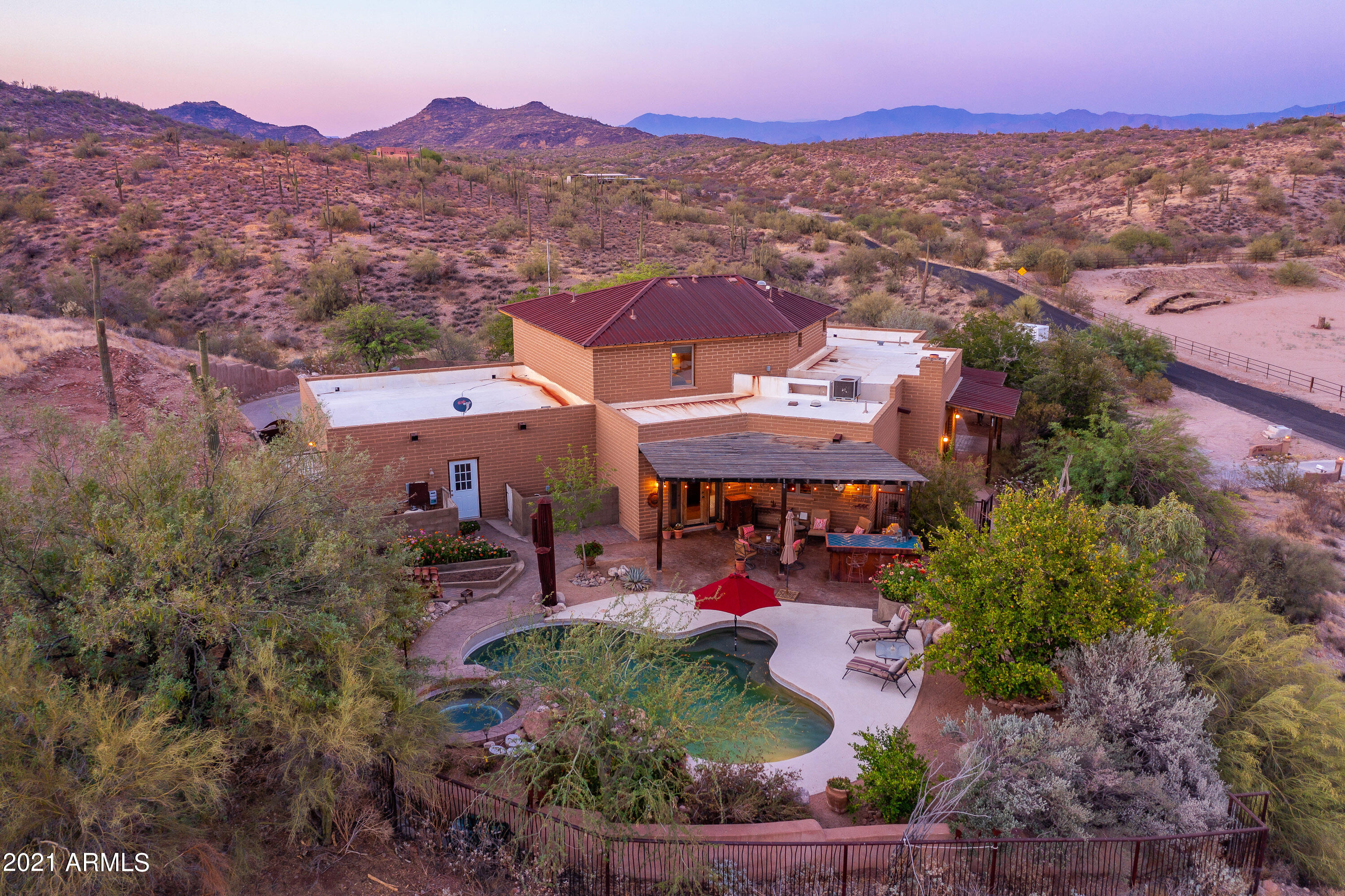 Amazing opportunity to own this gorgeous, quality custom-built Adobe home perfectly positioned on a hillside 4.5-acre lot! The solid 18'' adobe brick walls provide savings in energy year-round. As you enter you will love the flagstone flooring and open great room that is perfect for entertaining. The gourmet kitchen features hickory wood cabinets, stainless appliances and granite countertops. This home is truly one of a kind with alder wood doors, wood hickory flooring, and custom wood beams. The spacious master suite has a travertine shower, soaking tub, and walk-in closet. The backyard sanctuary features a saltwater pool/spa and covered patio space with an outdoor bar and barbecue area. There is a 2-3 horse barn and arena for the horse lover. Ride into the serene Tonto Forest and enjoy!