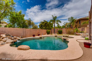 POOL 8' DEEP WITH ROCK WATERFALL FEATURE