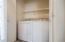 Laundry Closet with Shelving. Full Linen Closet Next to Laundry Closet
