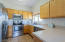 Kitchen with Built In Microwave and Oak Cabinets