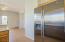 Cabinets Continue over Double Door Fridge