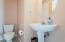 Convenient Half Bath with Pedestal Sink
