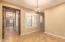Custom wood french doors to the game room/en-suite with its own private bathroom and sitting area