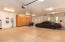 4 car garage with epoxy flooring and storage cabinets