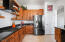 Gas Cooktop, Tile Backsplash Floating Shelves, Double Ovens.