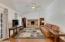 Vaulted family room w/brick wood burning fireplace & engineered hardwood floors