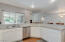 Recently remodeled kitchen w/granite counters, white cabinets & newer stainless appliances