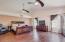 Spacious master suite w/engineered wood floors & vaulted ceilings