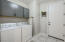Open laundry room with direct access to the 2 car garage!