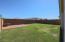 Spacious backyard, natural grass and pavers.