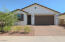 Welcome Friends! Front Elevation with desert landscape.