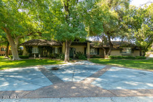 Large ranch home with circular drive.