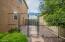 fenced dog run with dog door to indoor laundry room